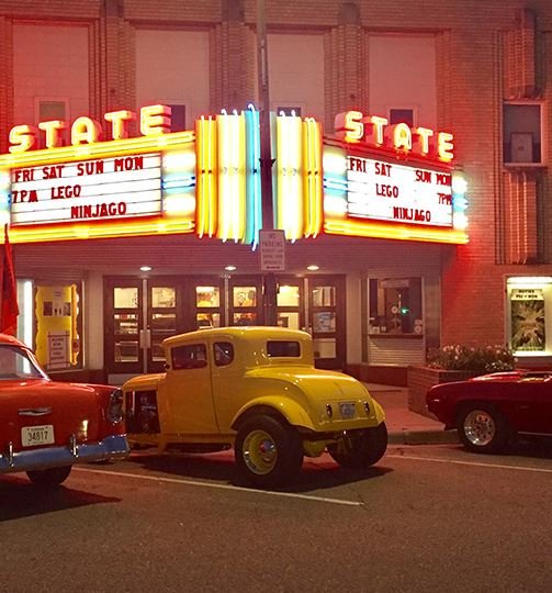 old cars parked at the theater